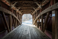 Looking down the inside of a covered wooden bridge in Lancaster County, PA.