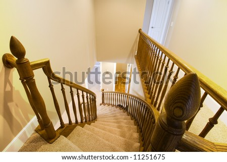 Looking down the Wooden Staircase in a Home