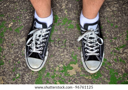 Looking down wearing casual shoes