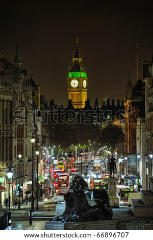 Looking down Whitehall towards Big Ben from Trafalgar Square, London, England, UK, at night in winter - stock photo