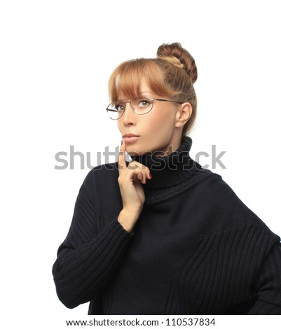 Looking for an idea.Portrait of thinking  woman with glasses.