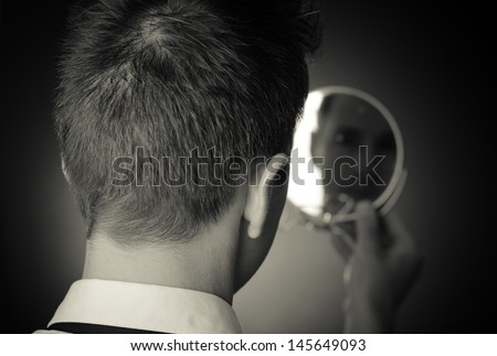 looking in the mirror and reflecting #145649093