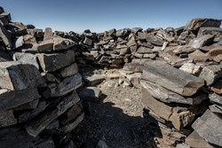 Looking Into Stacked Stone Wind Break that provides shelter for hikers on Wheeler Peak