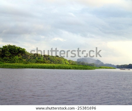 Looking north along Tortuguero's main channel to the ancient volcano that is the only relief in the area, Lemon, Costa Rica. Taken October 2008 - stock photo