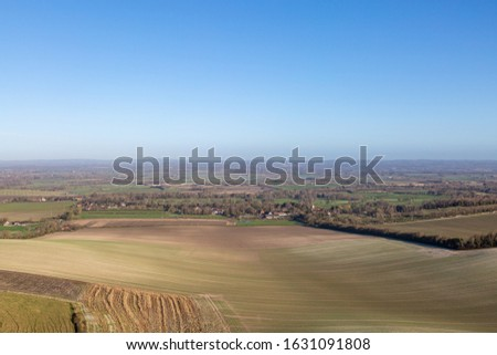 Looking out over fields and a vast landscape, from Firle Beacon in the South Downs stock photo
