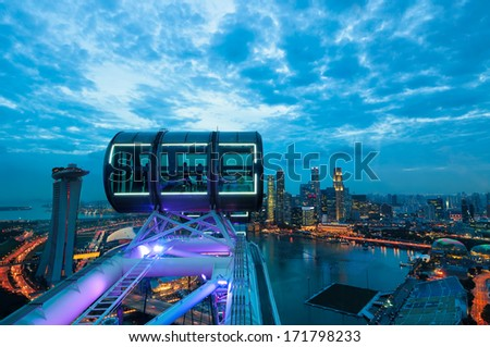 Looking out over the Singapore cityscape in early evening from the deck of the Singapore Flyer