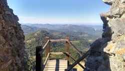 Looking out over viewing platform at Montsegur Cathar castle onto surrounding French countryside in Ariege, Occitanie, France
