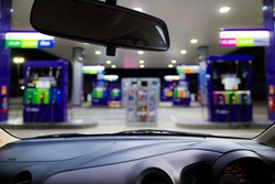 Looking out the car window to see gas station,use for product presentation related Images.