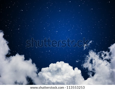 looking out to the stars in space or night sky through the clouds