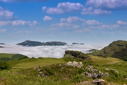 Looking over a sea of clouds in the mountains, on a clear day