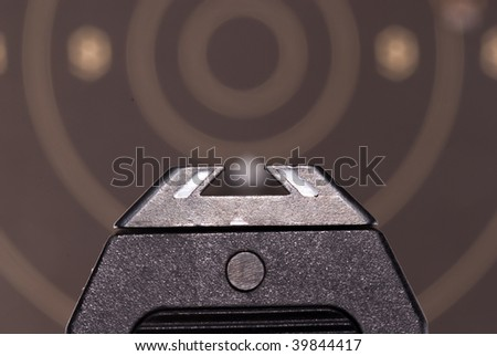 Looking over sights of a 9mm automatic pistol