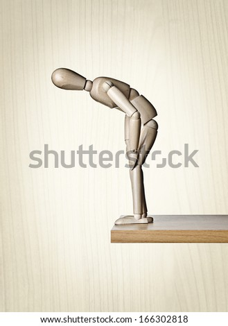 Looking over the edge, Manikin, anatomical model, placed on the edge of a board  #166302818