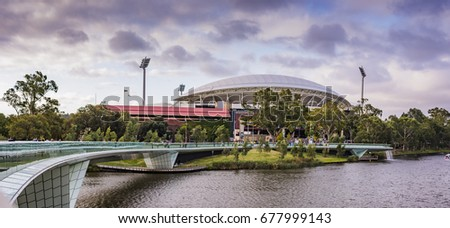 Looking over the River Torrens to the Adelaide Oval on Footy Day #677999143