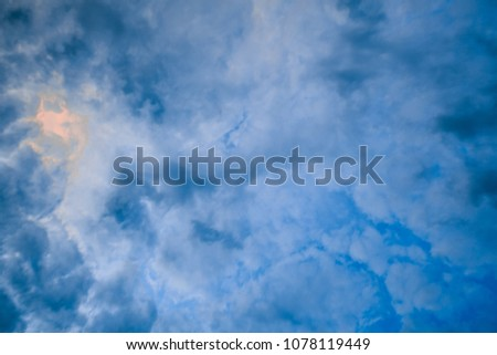 Looking straight up at beautiful clouds in the sky creating intricate abstract background