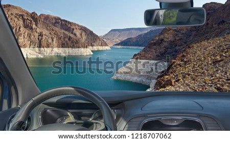 Looking through a car windshield with view of Colorado river in front of the Hoover Dam on the Nevada side, USA #1218707062