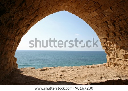 Looking through an archway onto the Mediterranean Sea at Apollonia National Park in Herzliya, Israel