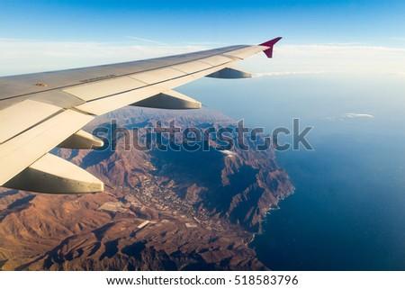 Looking through window aircraft during flight in wing with top view #518583796