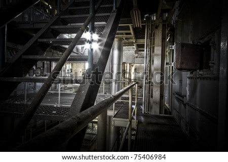 Looking trough the stairs at this abandoned power station, light shines trough as if its for the last time.