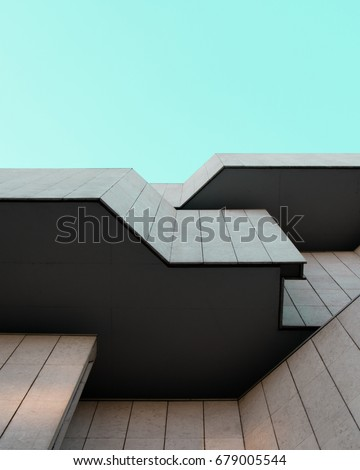 Looking up a modernist building facade #679005544