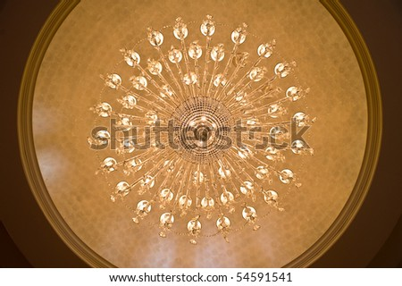 Looking up at a chandelier from below