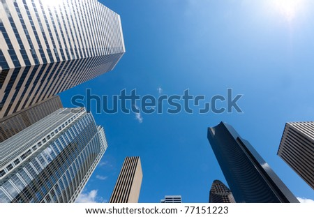 Looking up at a group of modern office buildings
