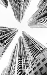 Looking up at futuristic skyscrapers in Dubai