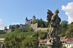 Looking up at Marienberg Fortress from the Alte Main Bridge. A landscape of Wurzburg, Germany, Romantic Road