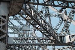 Looking up at metal beams and triangular shapes of Howrah bridge in Kolkata, India