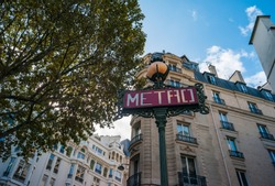 Looking up at sign while exiting subway station near Place Saint-Michel in central Paris
