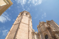 Looking up at the Church of our Lady of the Helpless at Plaza de la Virgen in Valencia, Spain