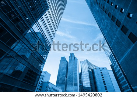 Photo of  Looking Up Blue Modern Office Building