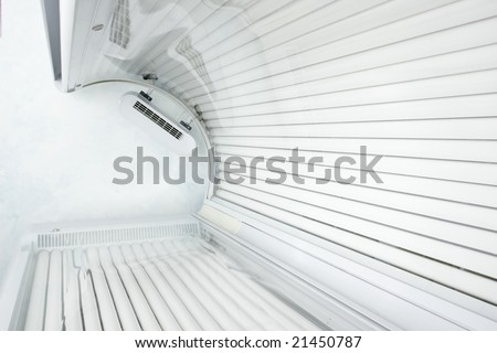 Looking up from inside a modern tanning bed.