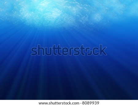 Looking up from under water, with sunrays streaming through water surface
