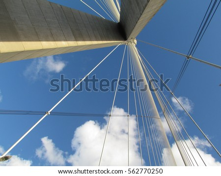 Looking  up. Futuristic abstract architecture modern structures of The Pont de Normandie. to the engineering construction. The cable-stayed road bridge's string. Sky clouds #562770250