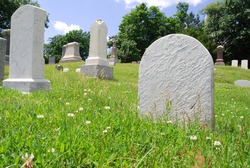 Looking up into a graveyard with blank tombstones