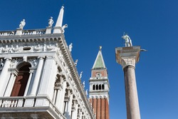 Looking up National library building, Campanile belltower and St. Theodore's column in St. Mark's Square, Venice, Italy