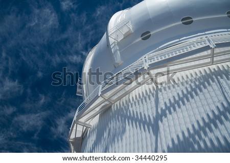 Looking up on the Canada-France-Hawai i Observatory atop the Mauna Kea volcano in Hawaii Big Island. - stock photo