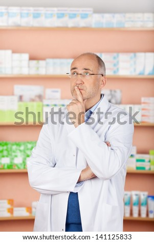 Looking up pharmacist thinking over the medicine backgrounds