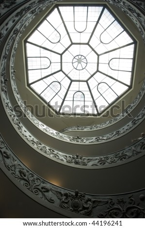 Looking up the infamous spiral staircase inside the Vatican Museums, Viale Vaticano, Vatican City, Rome, Italy.