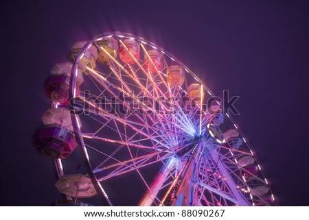 Looking up view of the ferris wheel at the carnival at night. #88090267