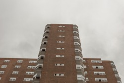 Looking up with a dramatic angle of apartment highrise on overcast day in Chicago Illinois