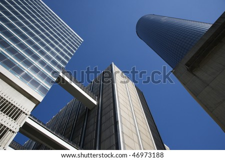 Looking upwards at skyscrapers in downtown Atlanta with a clear blue sky in the background. Horizontal shot.
