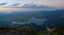 lookout point herzogstand with view to lake kochelsee and riegsee in the evening