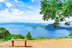 Lookout point with resting wooden bench. Beautiful scenery of nature with a large reservoir above the Srinagarind Dam at Rai Ya Yam view point in Si Sawat District, Kanchanaburi Thailand.