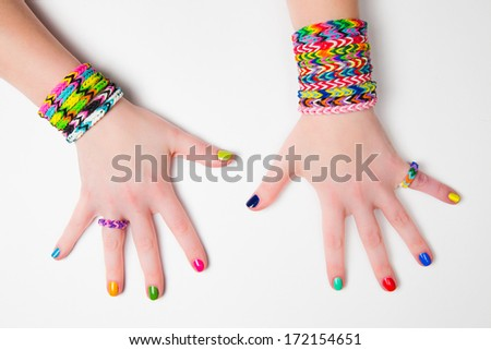 Loom bracelets on a young girl's hand Close up Young fashion concept