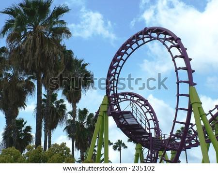 Looping roller coaster, back lit