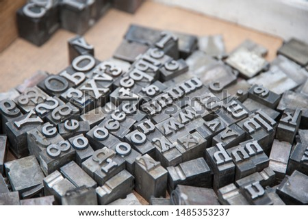 Loose letters from typeset of ancient typewriter