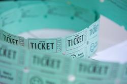 Loose roll of green carnival raffle tickets