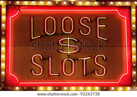 Loose Slot sign on a casino wall