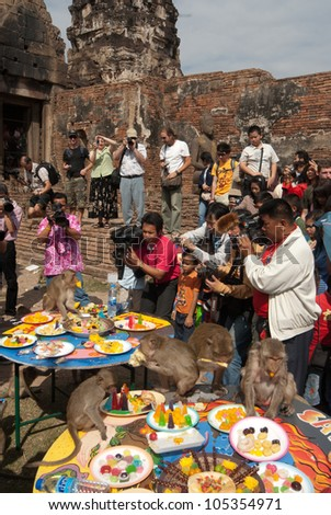 LOPBURI,THAILAND-NOV. 30:Monkeys enjoys the annual Monkey Buffet Festival at  temple more than 2,000 kg of fruits and vegetables were used during the festival. at November 30,2011,Lopburi,Thailand.
